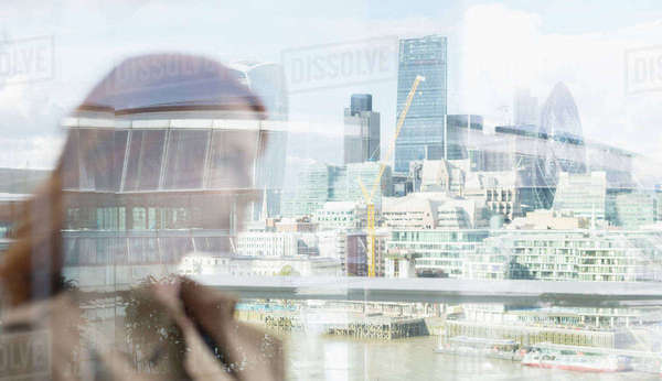 Businesswoman on urban balcony with city view, London, UK Royalty-free stock photo