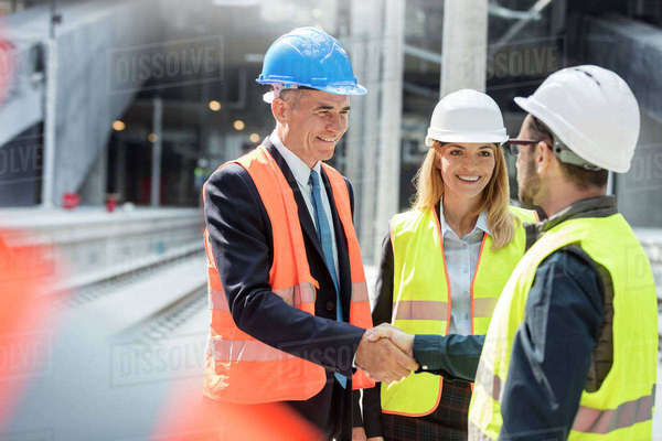 Businessman and engineer handshaking at construction site Royalty-free stock photo