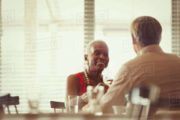 Senior couple drinking wine, dining at restaurant table Royalty-free stock photo