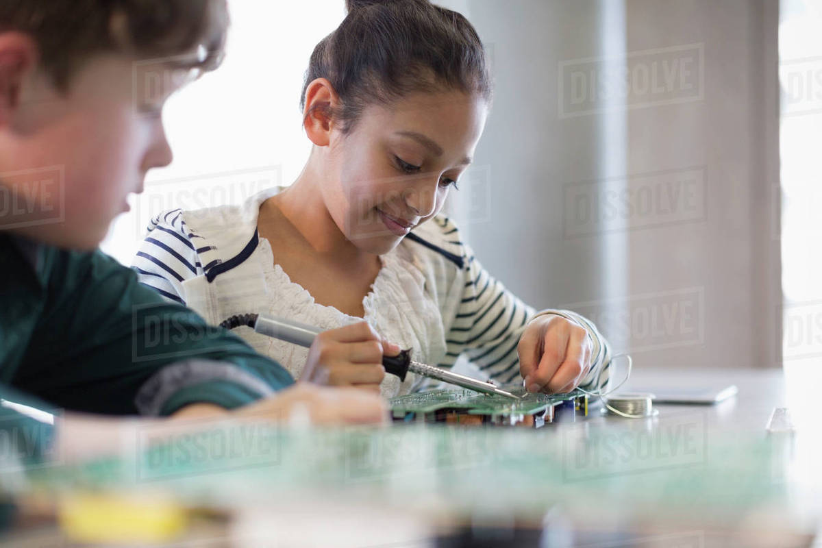 Students Soldering Circuit Board In Classroom Stock Photo Dissolve Rcuit