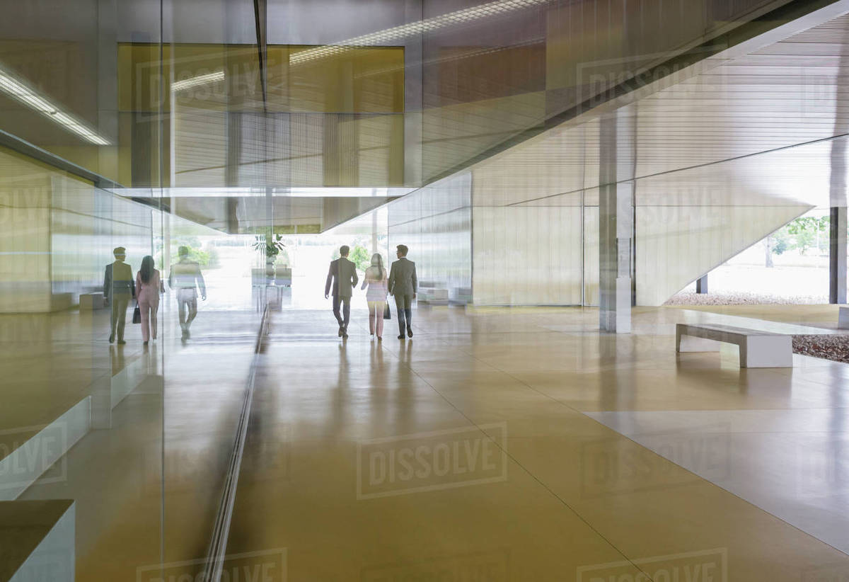 Business People Walking In Modern Office Lobby Corridor
