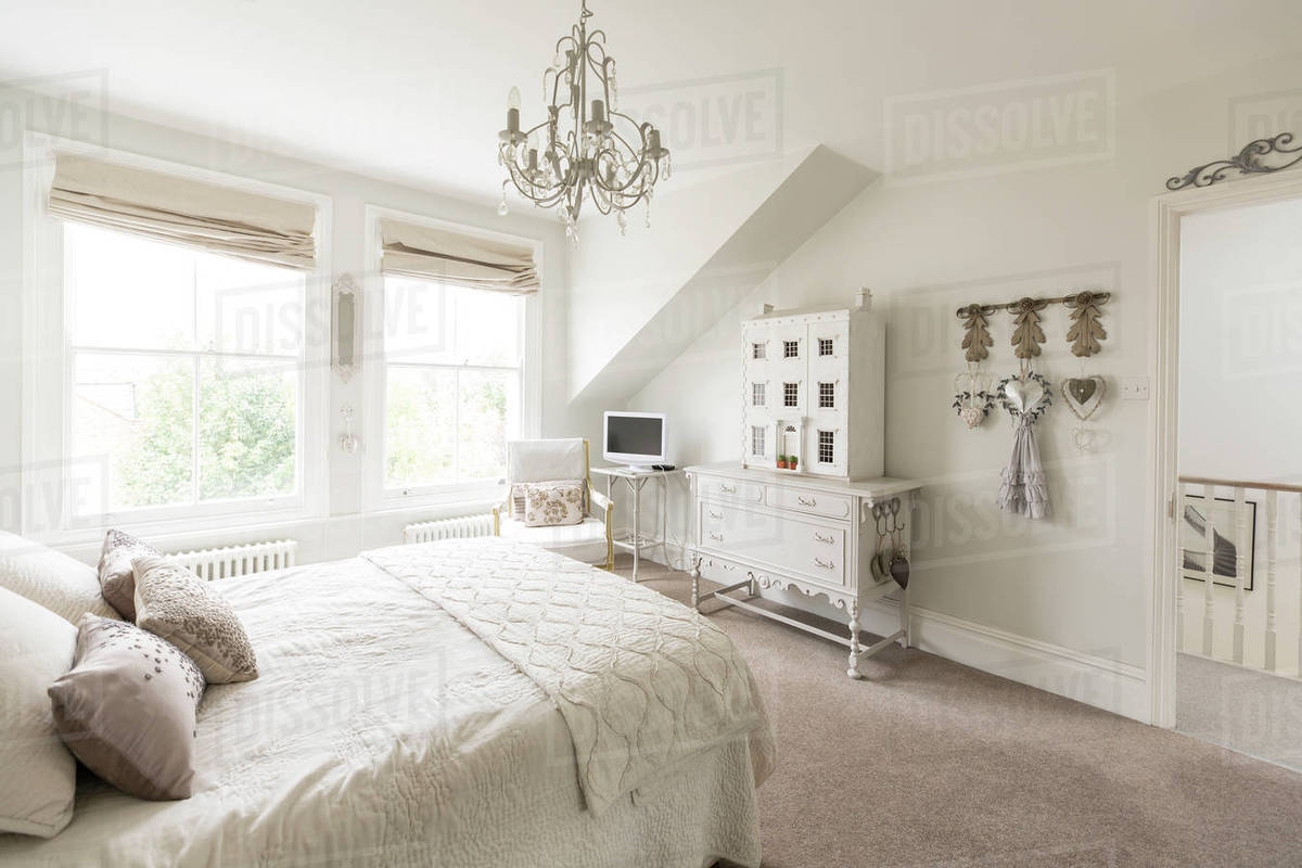 White, luxury home showcase interior bedroom with chandelier - Stock ...
