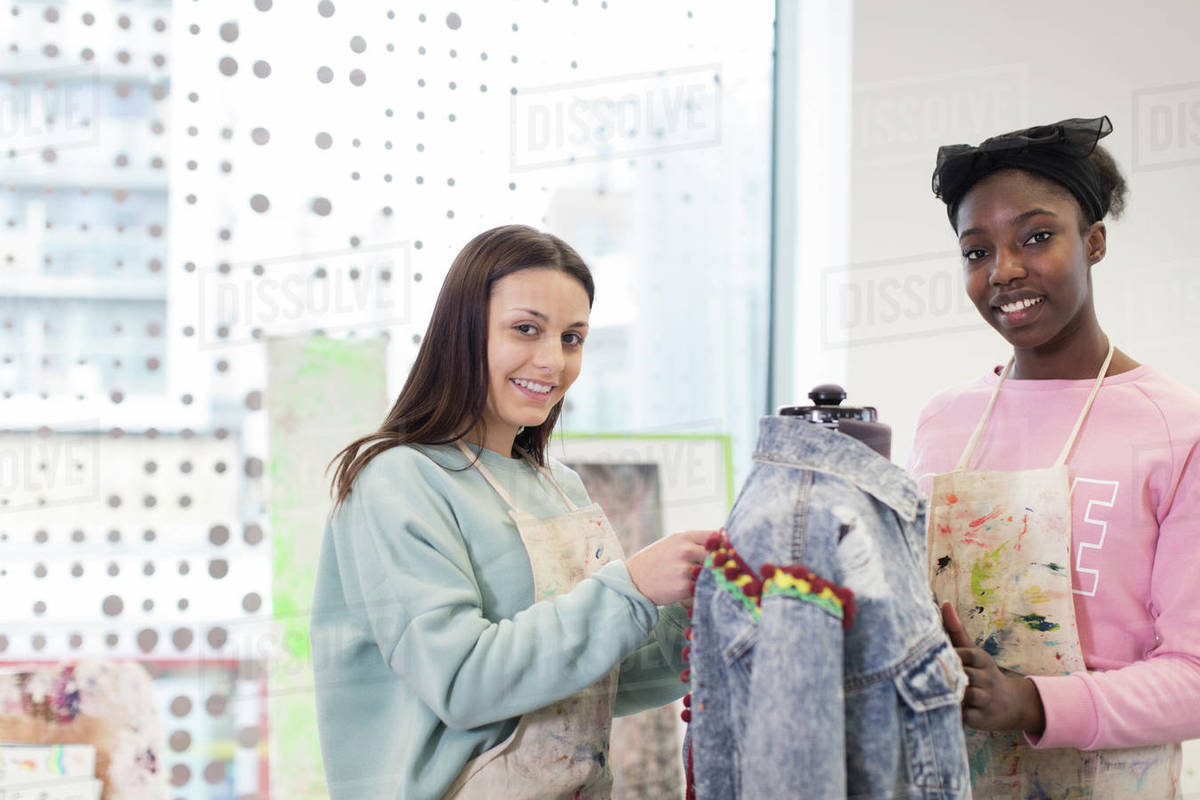 Portrait Smiling Teenage Girls Designing Denim Jacket In Fashion Design Class Stock Photo Dissolve