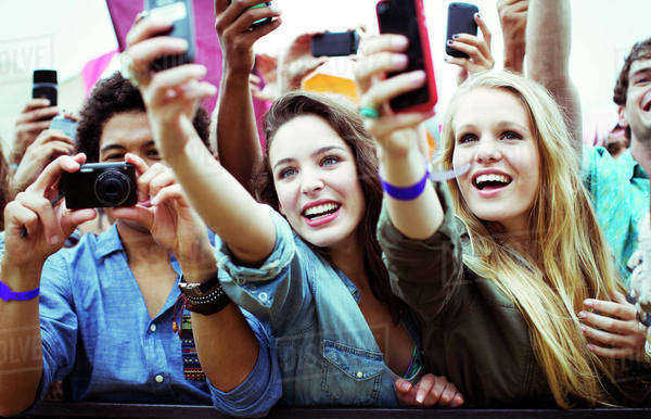 Fans with cameras and camera phones at music festival Royalty-free stock photo