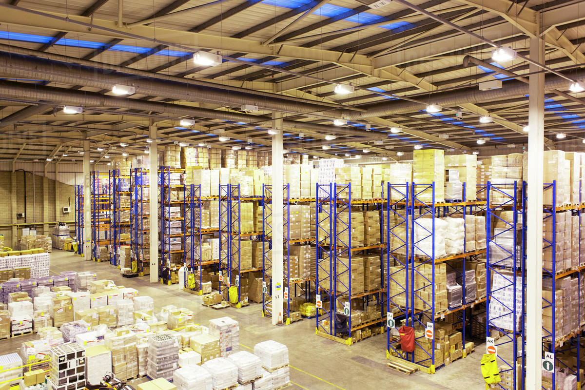 stacks of boxes in warehouse stock photo dissolve
