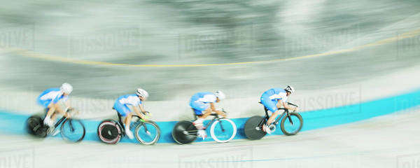 Track cycling team racing in velodrome Royalty-free stock photo