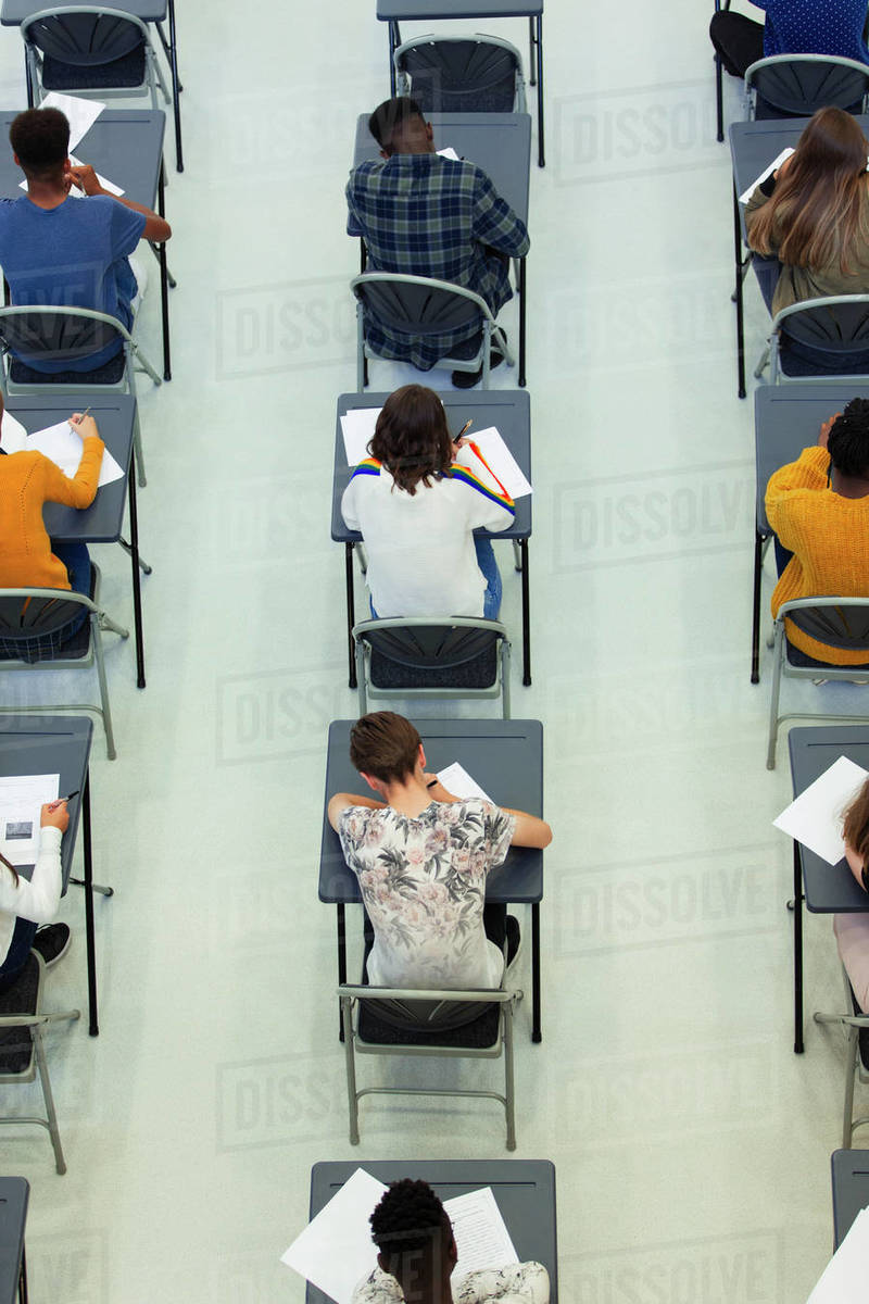 View from above high school students taking exam at desks in classroom Royalty-free stock photo