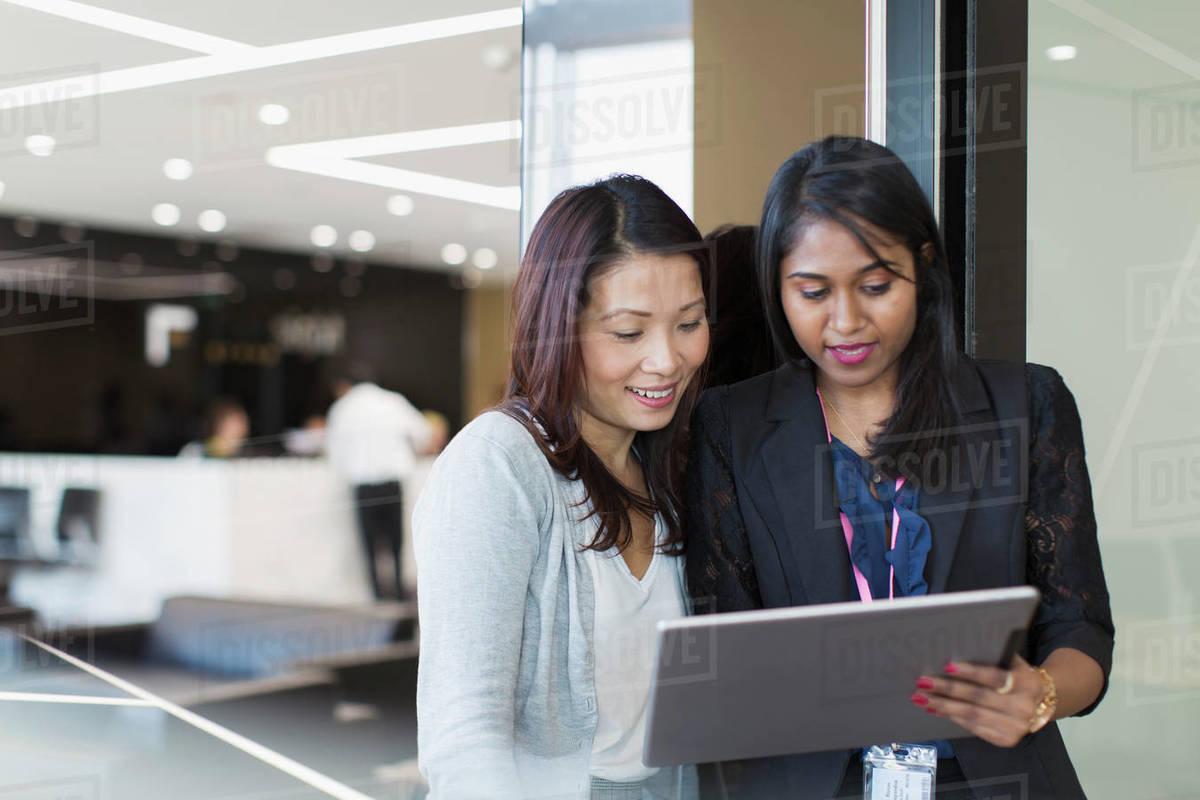 Businesswomen using digital tablet in office Royalty-free stock photo