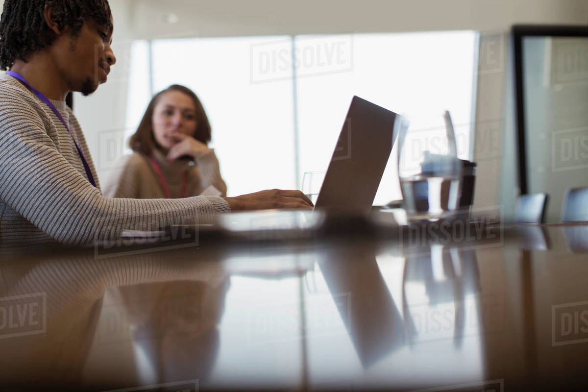 Business people planning at laptop in conference room meeting Royalty-free stock photo