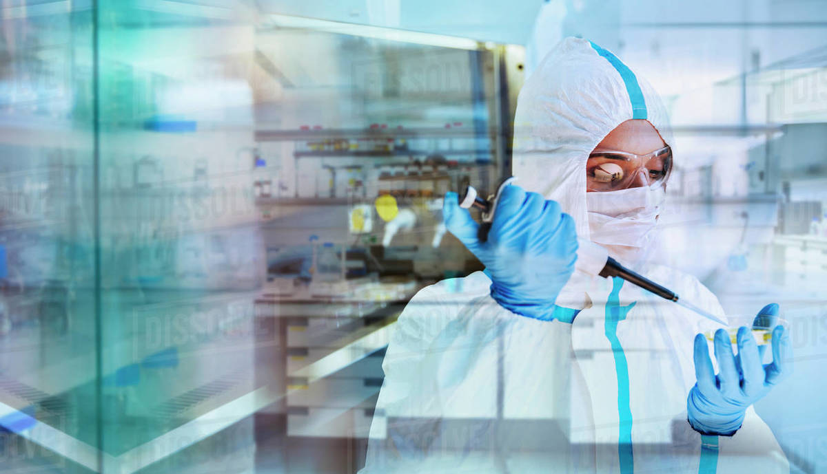 Female scientist in clean suit researching coronavirus in laboratory Royalty-free stock photo