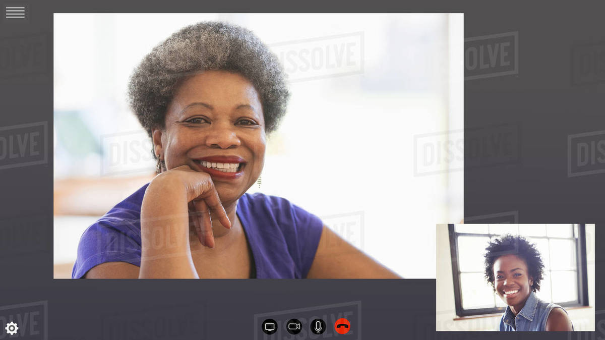 Happy mother and daughter video conferencing in COVID-19 quarantine Royalty-free stock photo