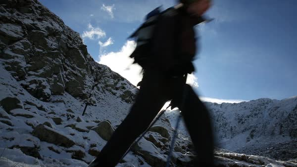 Hand-held shot of a man and a woman hiking in Fagaras Mountains Royalty-free stock video