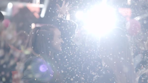 Slow motion shot of confetti falling on young women at a concert Royalty-free stock video