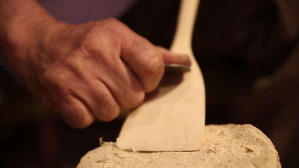 Close-up of a man making a wooden spoon Royalty-free stock video