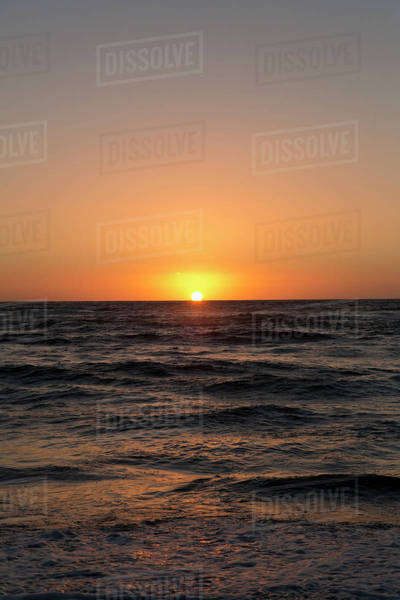 Sun setting on the sea Royalty-free stock photo