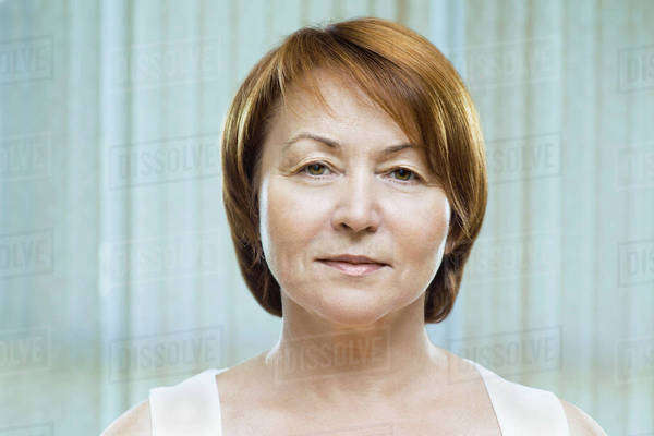 A mature woman looking serenely into the camera Royalty-free stock photo