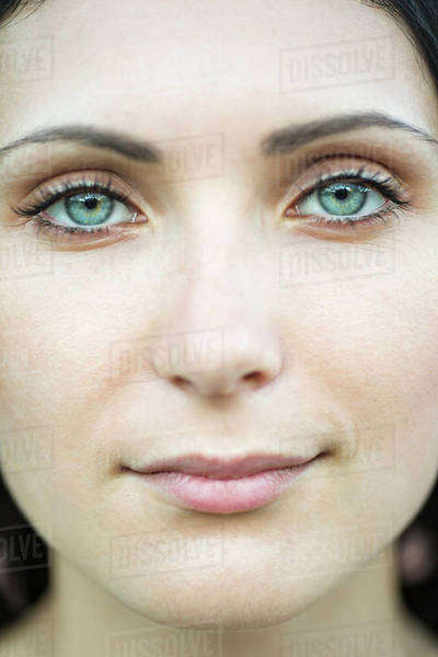 A beautiful woman staring serenely into the camera, close-up of face Royalty-free stock photo