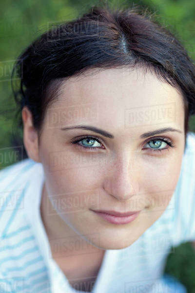 A beautiful young woman looking serenely into the camera Royalty-free stock photo
