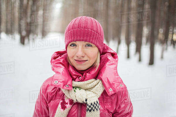 A young woman wearing warm clothing outdoors in winter Royalty-free stock photo