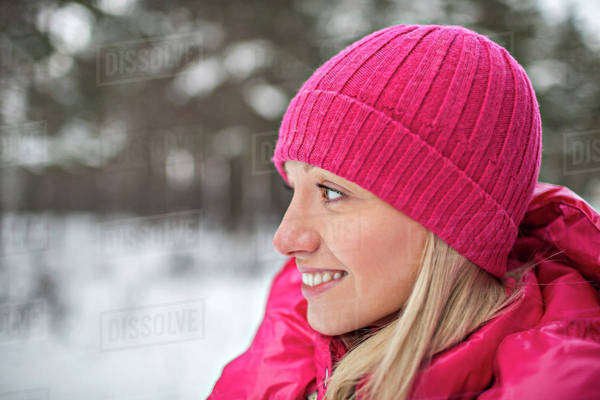 A woman wearing bright pink winter clothing outdoors Royalty-free stock photo