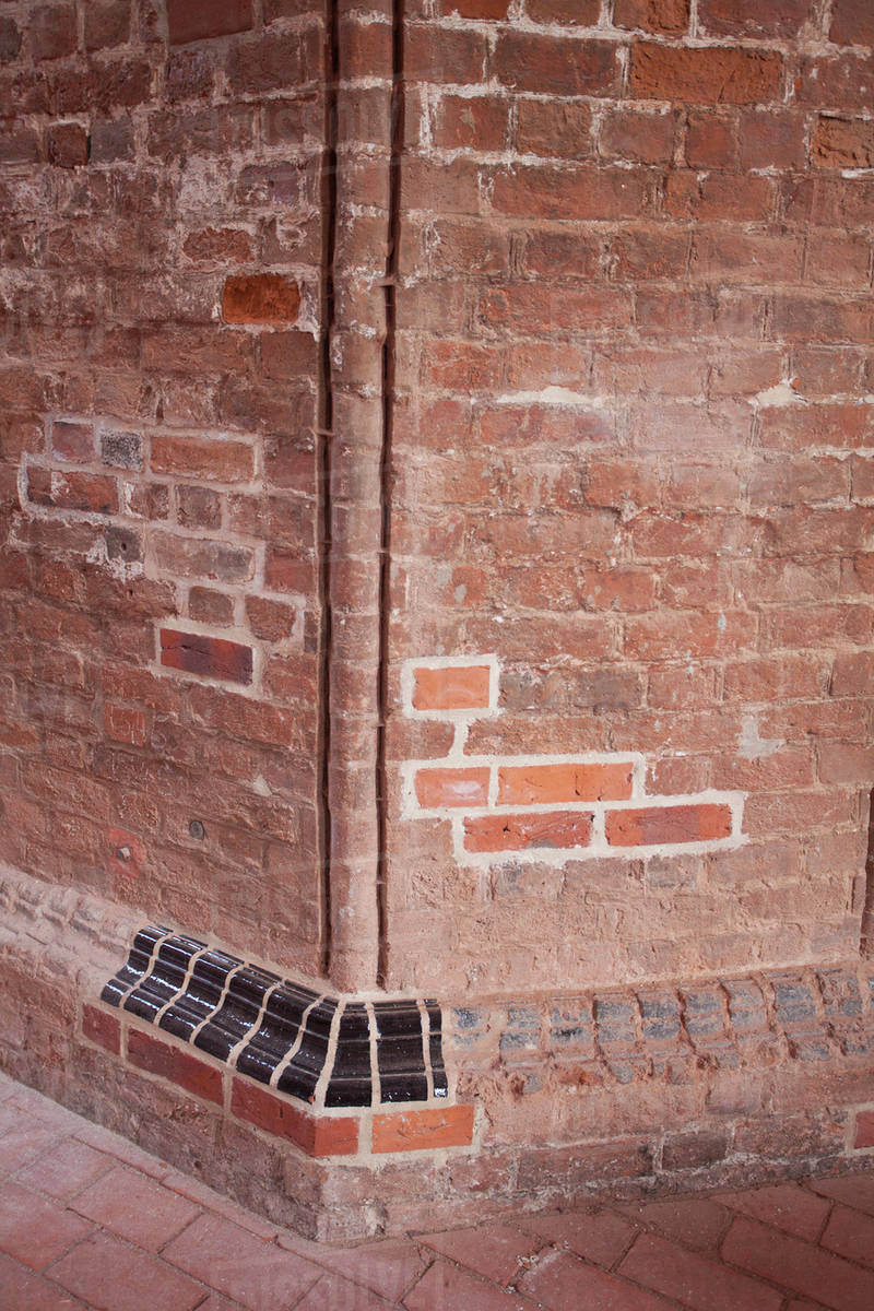 Old Wall Red With Some New Bricks