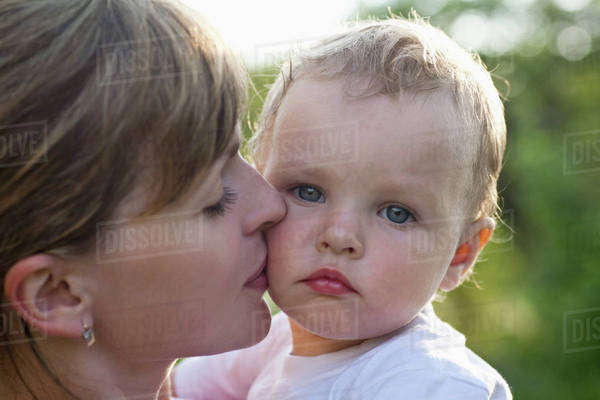 Mother kissing her son, close-up Royalty-free stock photo