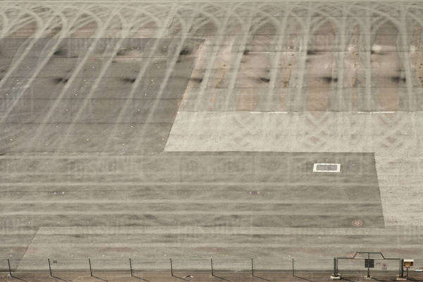 Tire tracks making a pattern on a sports track Royalty-free stock photo