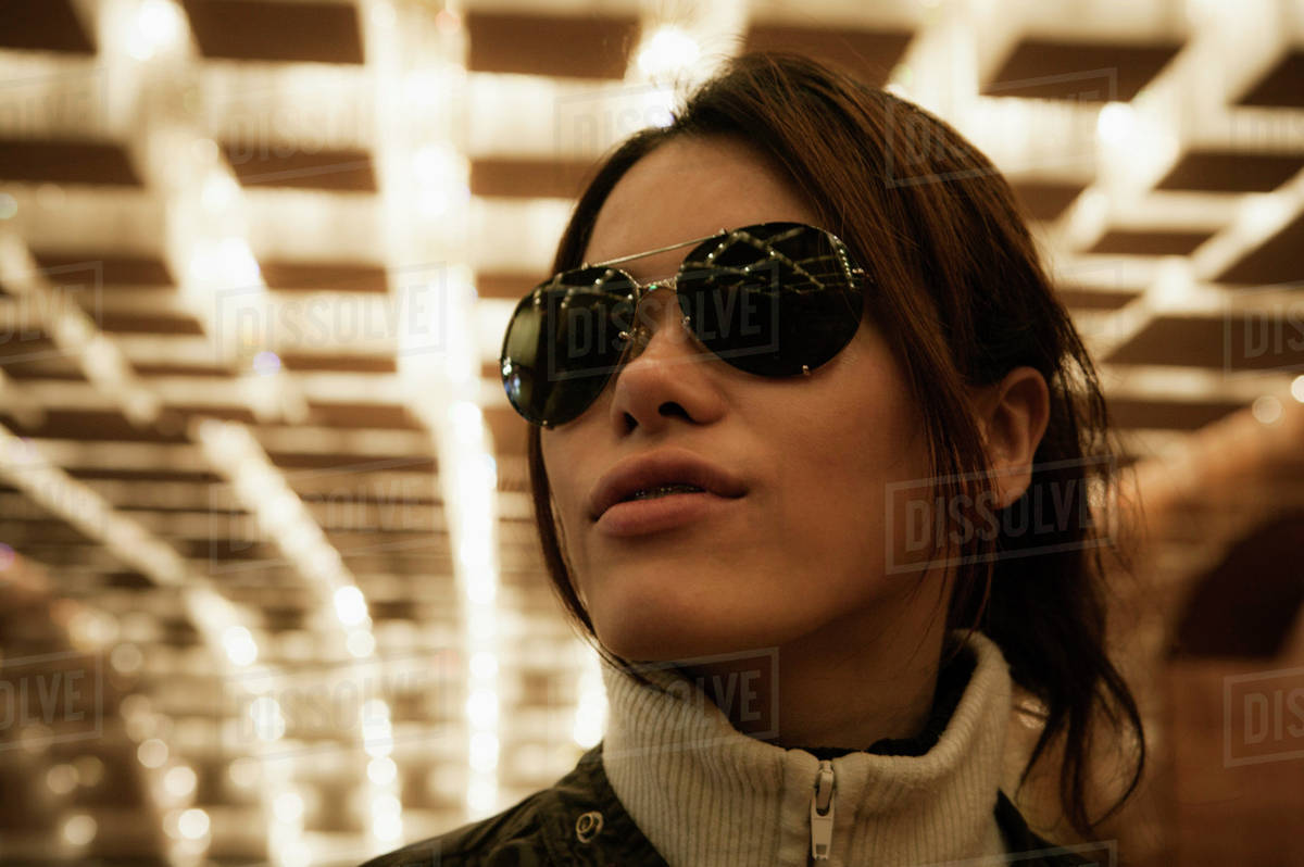 d5809f9bce82 Close-up of mid adult woman wearing sunglasses in tunnel Royalty-free stock  photo