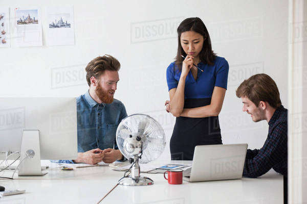 Young business coworkers discussing at desk Royalty-free stock photo
