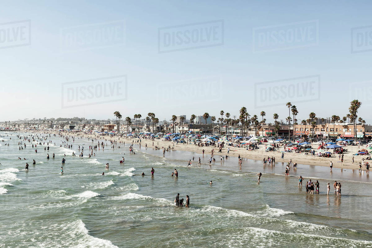 People On Beach Against Clear Sky Newport California Usa