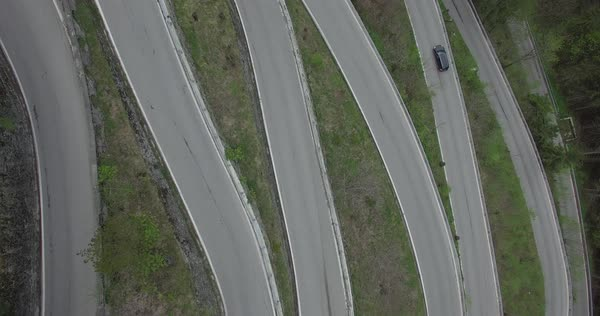Aerial view of cars moving on windy road, Spluegen Pass, Italy Royalty-free stock video