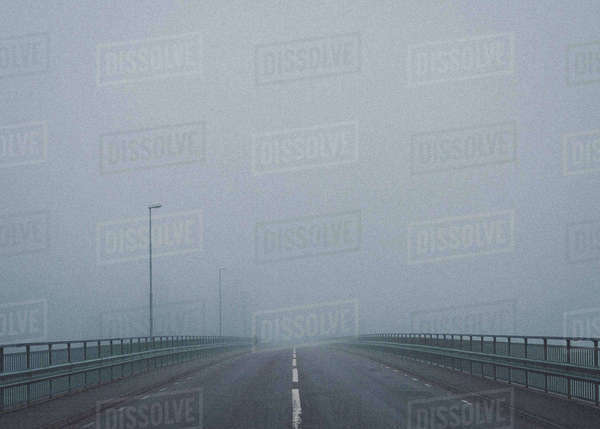Road on bridge against sky during foggy weather Royalty-free stock photo