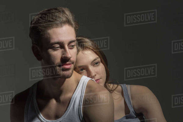 Thoughtful young couple against gray background Royalty-free stock photo