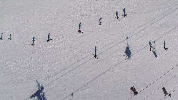 Aerial view of people skiing near ski lift Royalty-free stock video