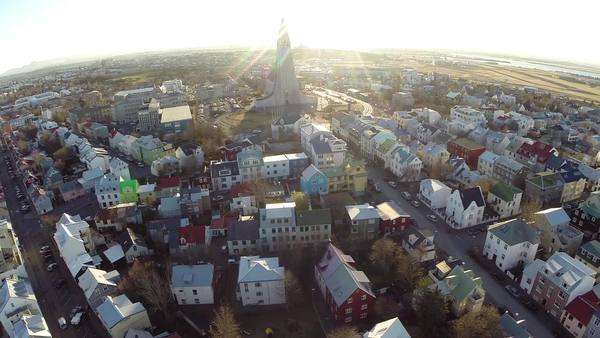 Reykjavik, Iceland: Aerial view of Hallgrimskirkja church amidst the city Royalty-free stock video