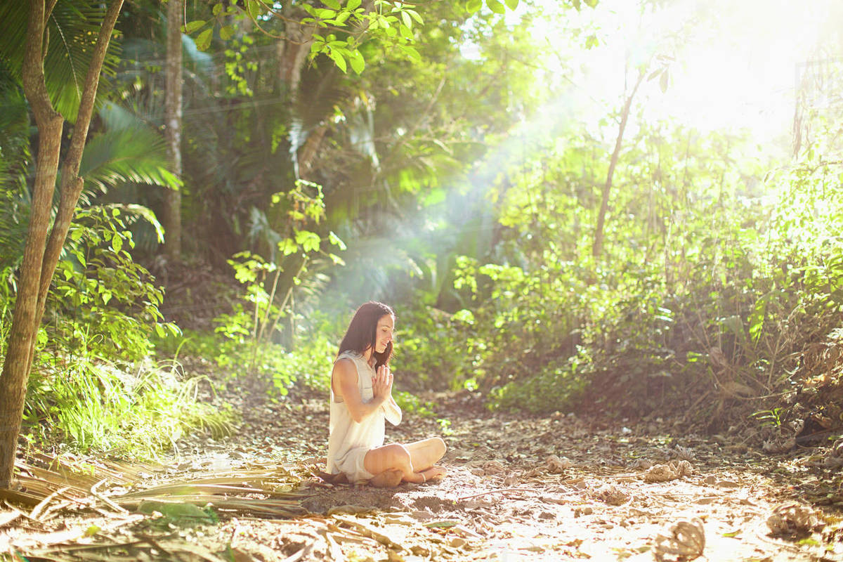 Serene woman meditating in sunny, tranquil woods, Sayulita, Nayarit, Mexico Royalty-free stock photo