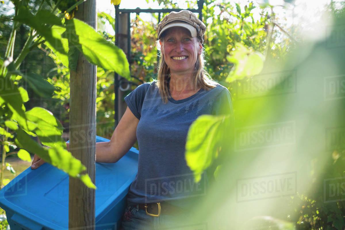 Portrait confident smiling farmer in sunny vegetable garden Royalty-free stock photo