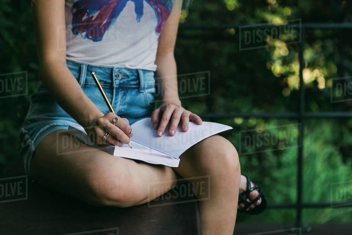 Young woman writing in journal Royalty-free stock photo