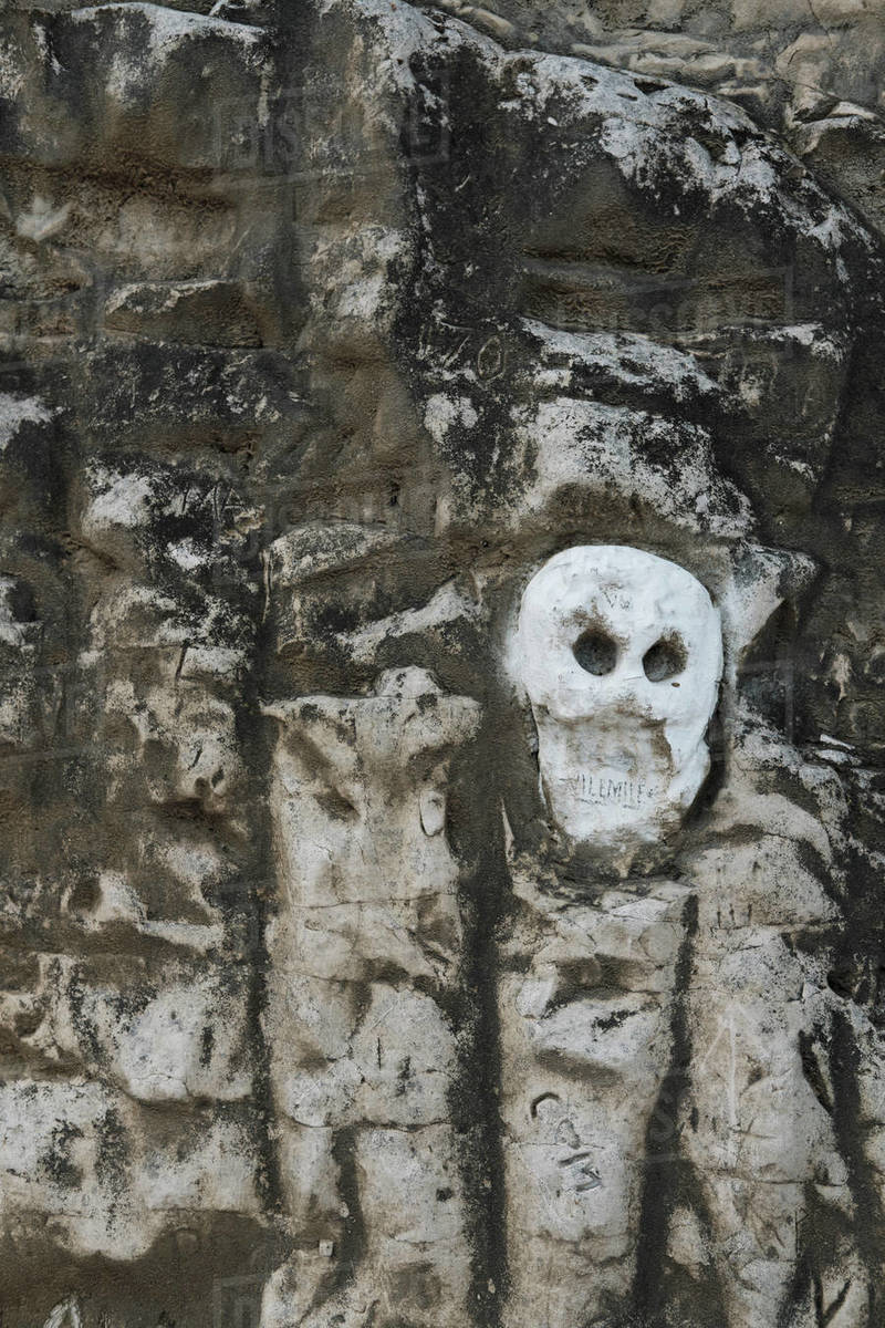 Skeleton face carved into rock Royalty-free stock photo