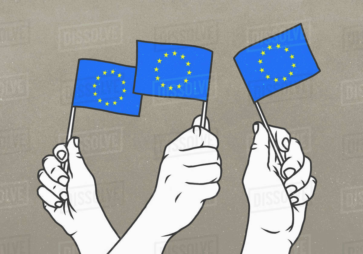 Hands waving small European Union flags Royalty-free stock photo