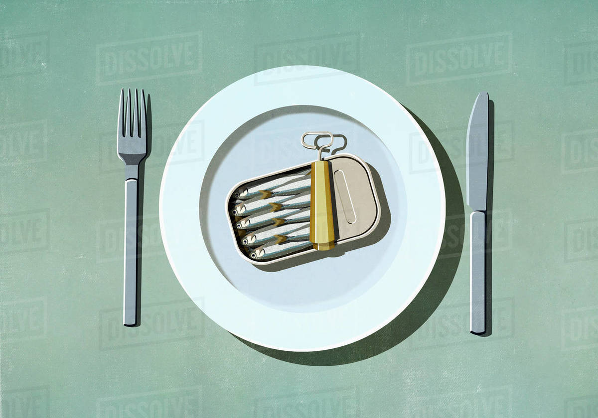 Can of sardines on plate Royalty-free stock photo