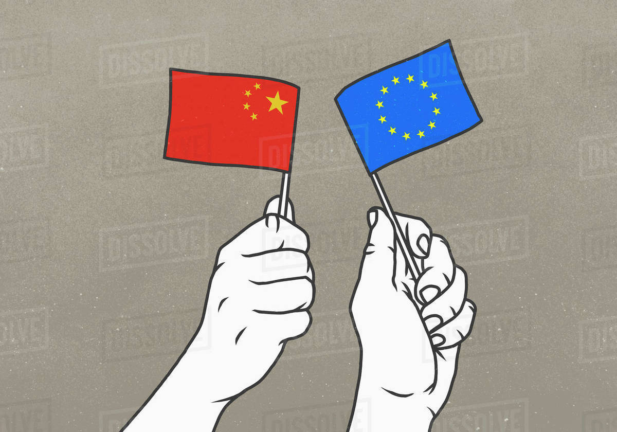 Hands waving Chinese and European Union flags Royalty-free stock photo