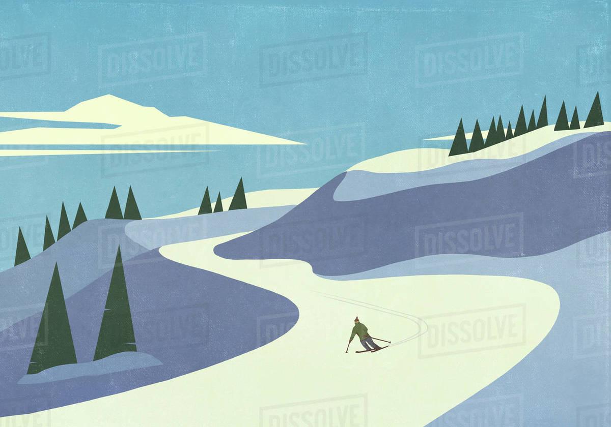 Skier descending snowy mountain slope Royalty-free stock photo