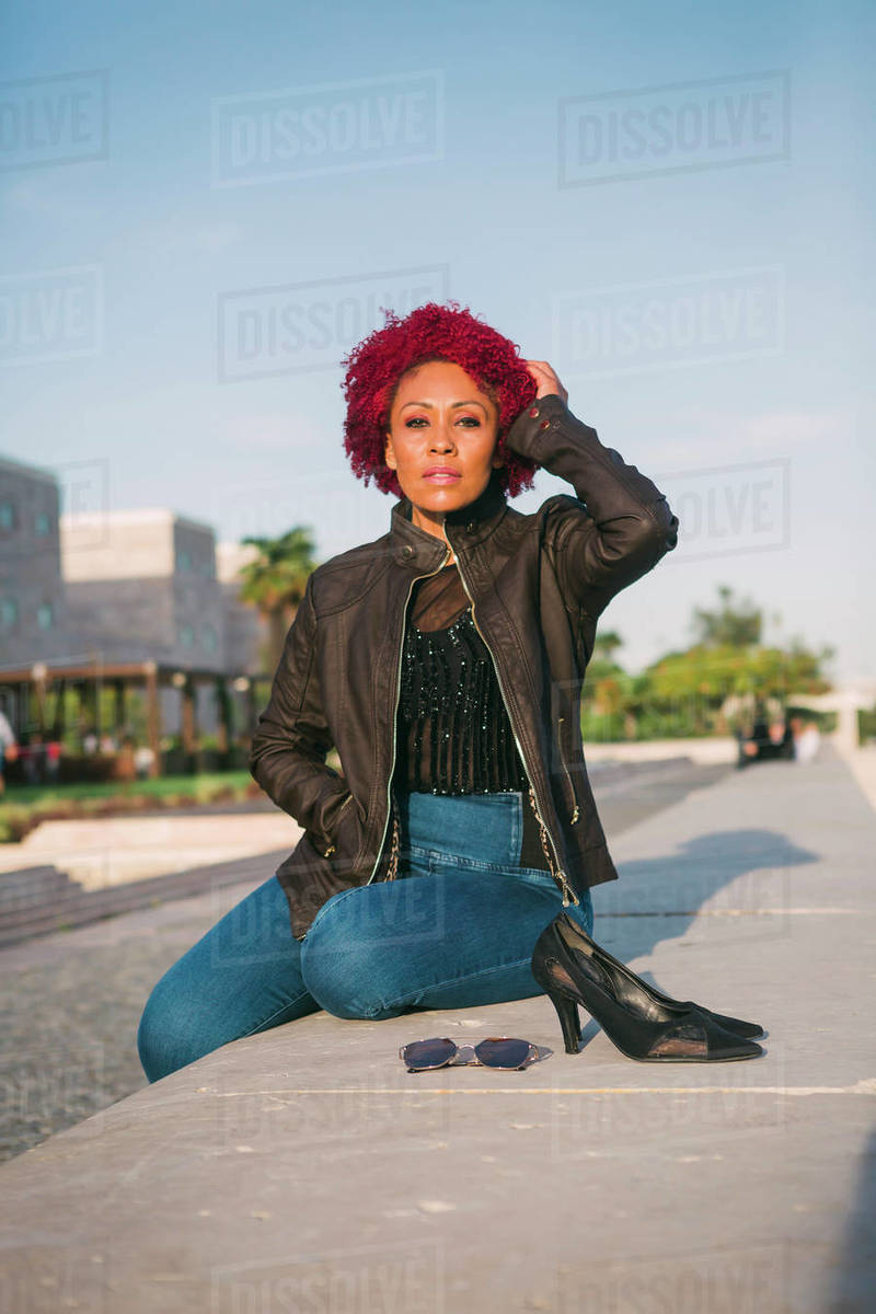 Portrait confident, stylish woman relaxing in urban park Royalty-free stock photo