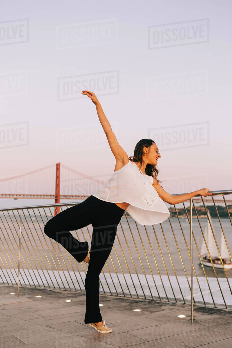 Graceful female dancer at waterfront Royalty-free stock photo
