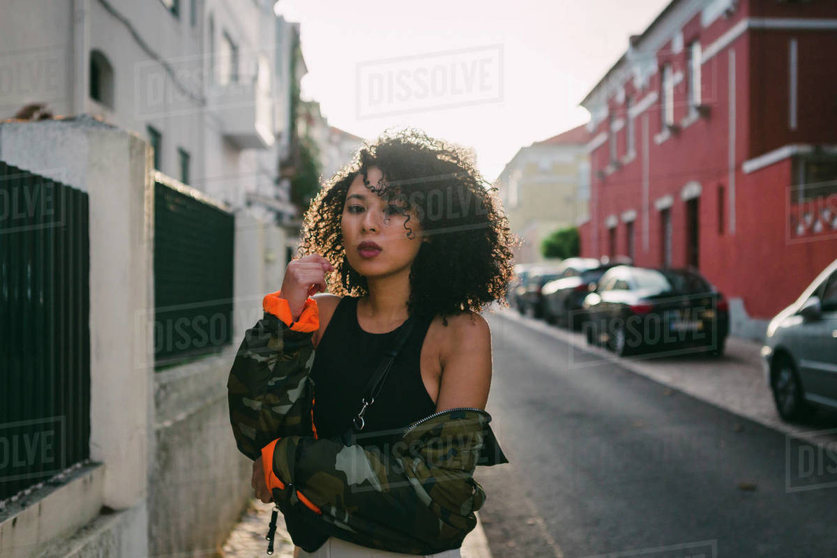 Portrait confident, cool young woman on urban street Royalty-free stock photo