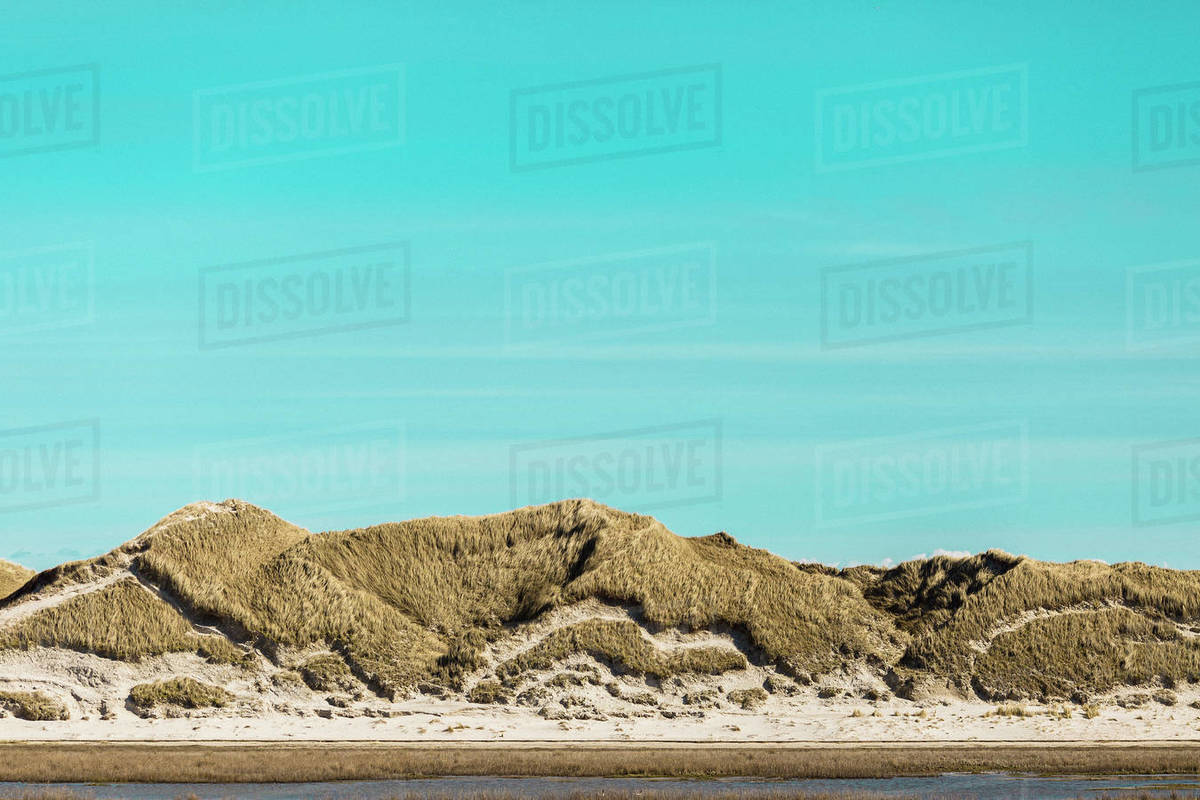 Tranquil sand dunes under sunny blue sky, Norddorf, Schleswig Holstein, Germany Royalty-free stock photo