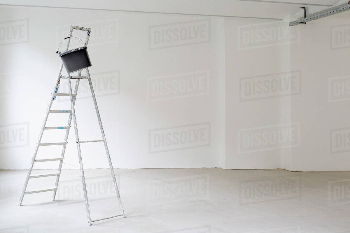 Ladder in empty room at construction site Royalty-free stock photo
