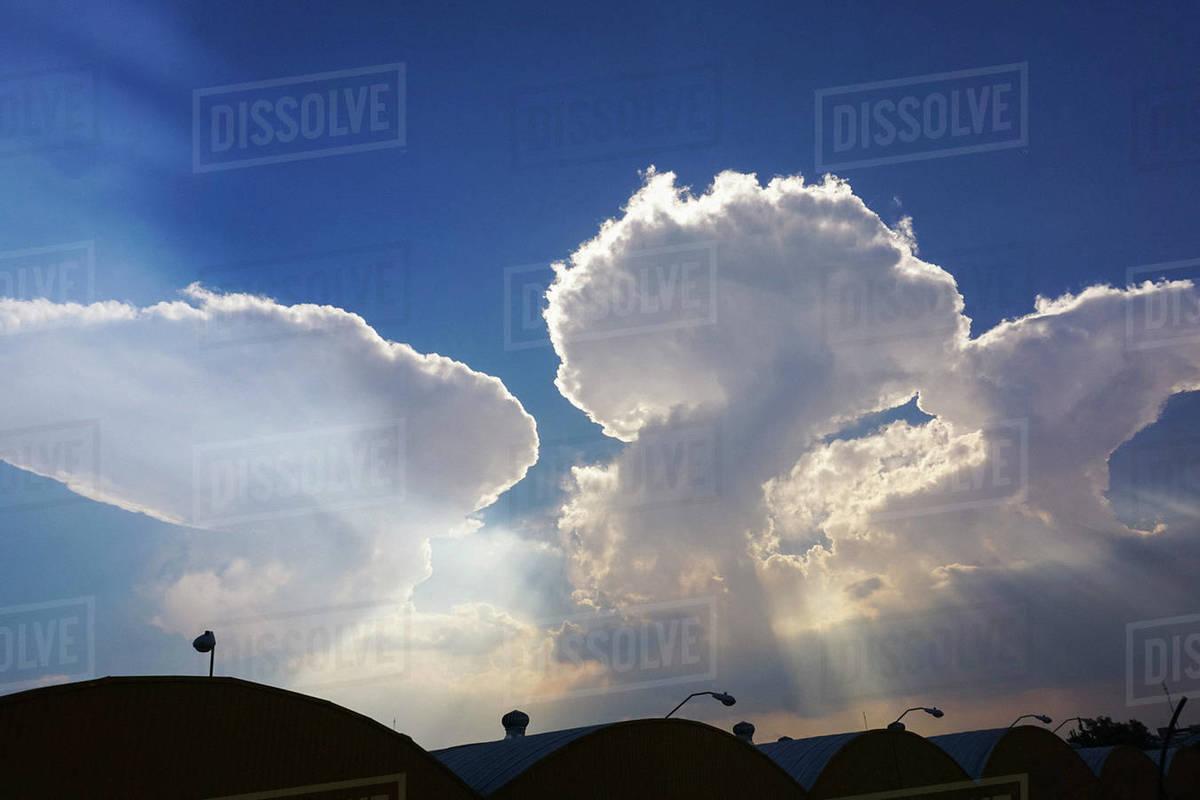 Cumulonimbus clouds in sunny sky Royalty-free stock photo
