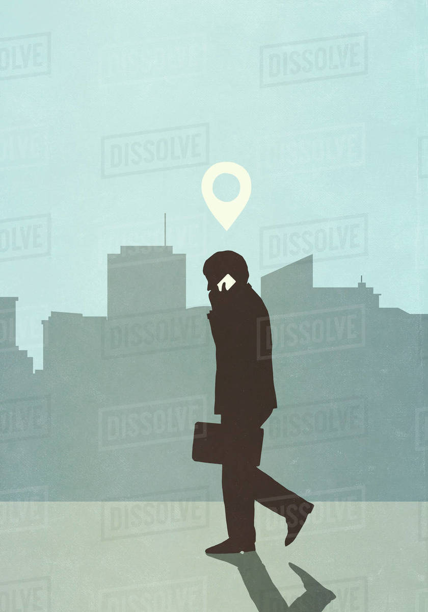 Map pin icon above businessman walking and talking on smart phone in city Royalty-free stock photo